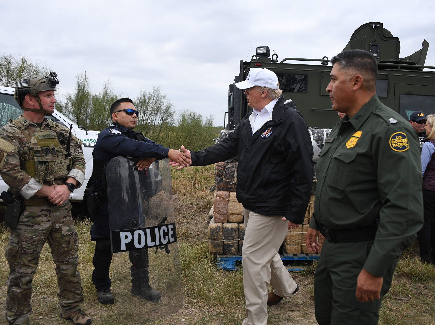 President Donald Trump greets a policeman with Border Patrol agents,and military after his visit to US Border Patrol McAllen Station in McAllen, Texas, on Jan. 10, 2019.