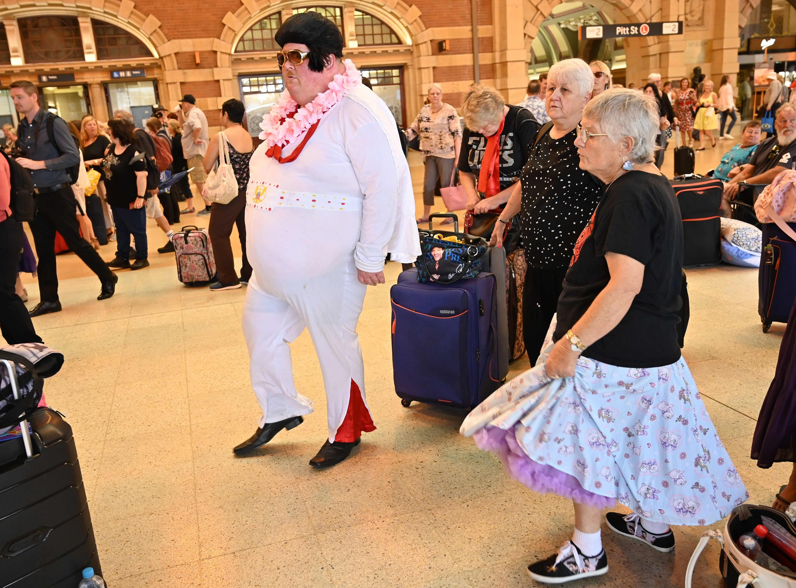 Break it down now! Elvis fans dance to Elvis songs at Central Station before boarding a train to to The Parkes Elvis Festival.