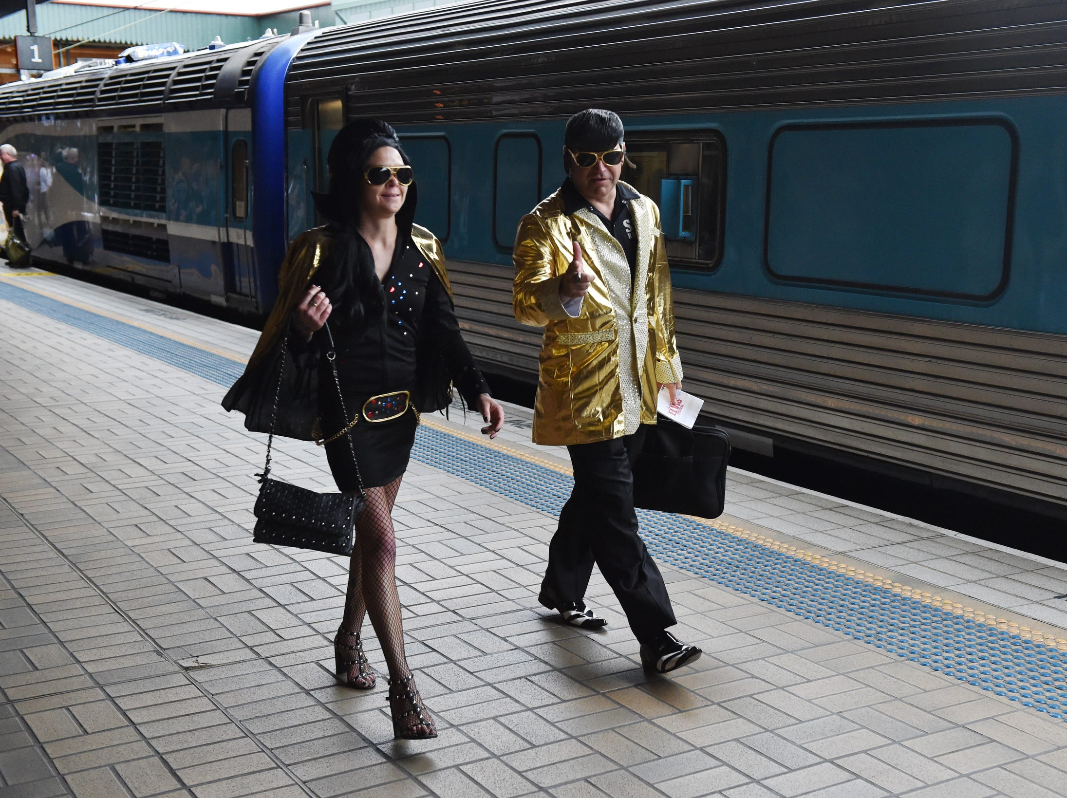 Elvis impersonators and fans board the Elvis Express at Central Station.