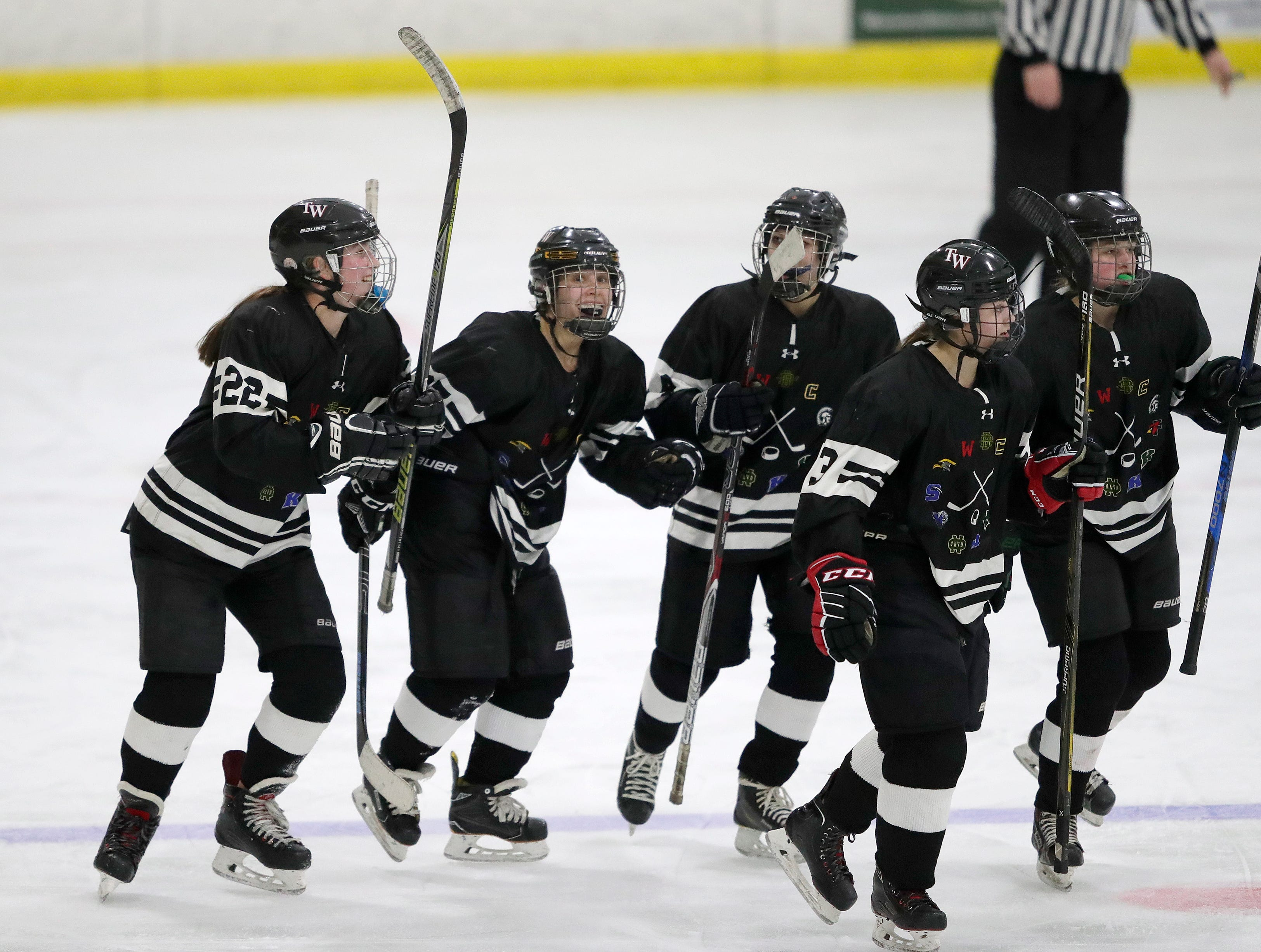 The Warbirds' Alyssa Heim, second from left,celebrates scoring a goal with teammates against Fox Cities Stars' Hattie Berndt (33) during their girls hockey game Thursday, January 10, 2019, at Tri-County Ice Arena in Fox Crossing, Wis. 