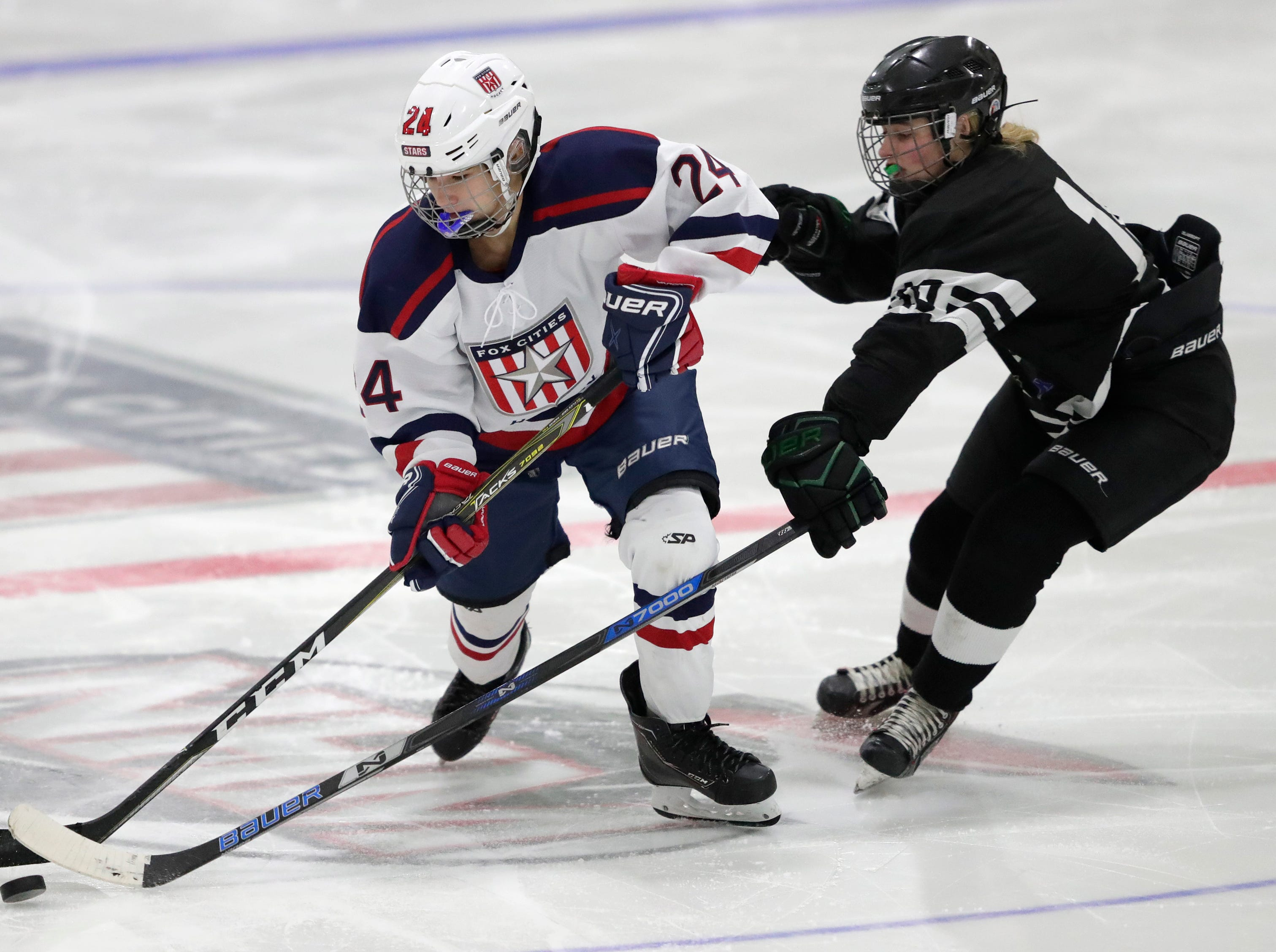 Fox Cities Stars' Hanna Hiltunen (24) controls the puck against the Warbirds' Jenna Kirschbaum (10) during their girls hockey game Thursday, January 10, 2019, at Tri-County Ice Arena in Fox Crossing, Wis. 