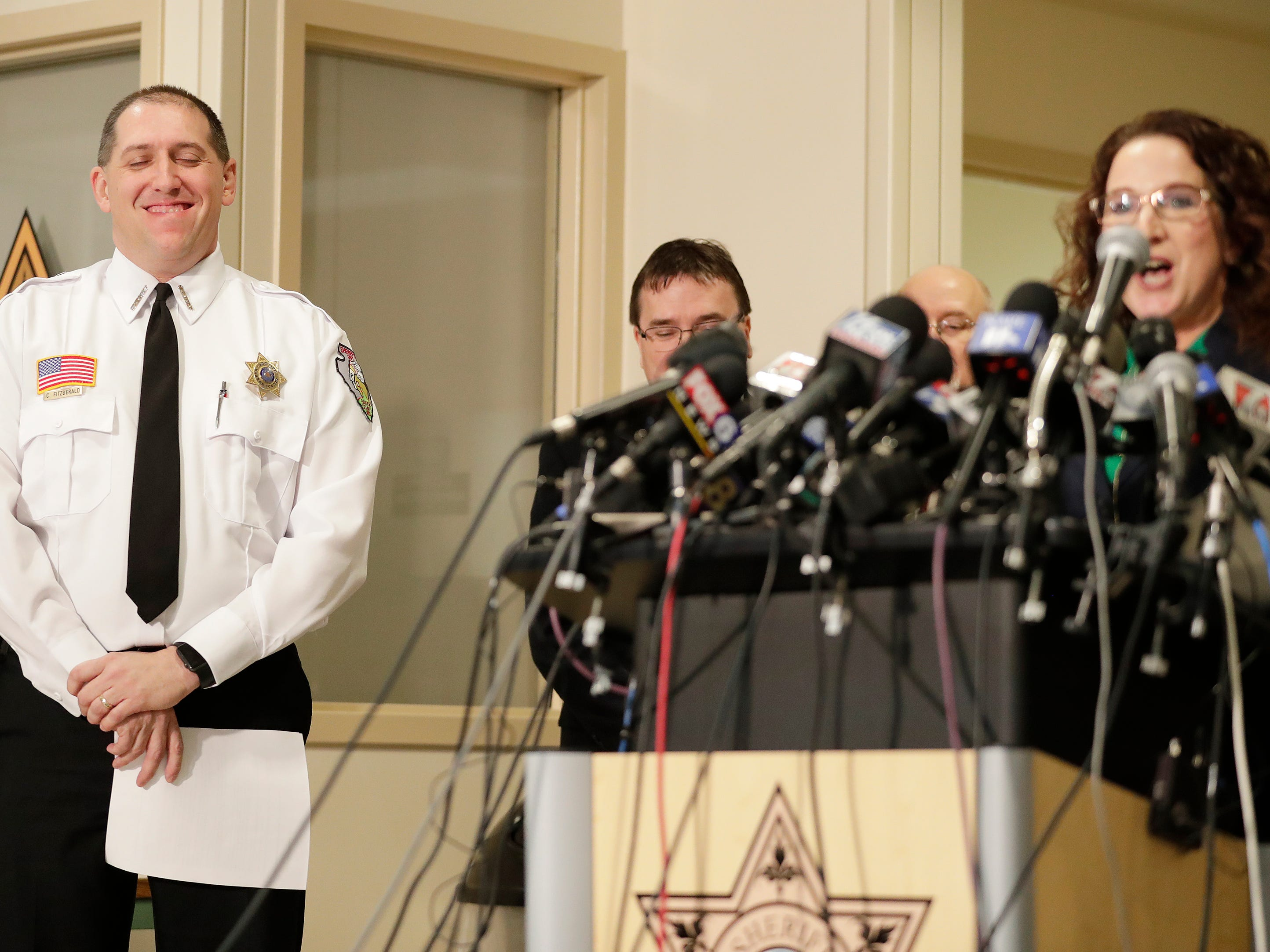 Barron County Sheriff Chris Fitzgerald smiles as Diane Tremblay, Superintendent of the Barron Area School District  talks about Jayme Closs being found during a press conference at the Barron County Sheriff's Department on Friday, January 11, 2019 in Barron, Wis. Douglas County officials found 13-year-old Jayme Closs on Thursday near the northern Wisconsin town of Gordon. Jayme had been missing since Oct. 15, the same day her parents, James, 56, and Denise, 46, were found shot to death in their home outside Barron.