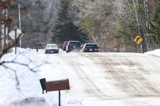 Investigative squad vehicles seen heading to the property where Jayme Closs was kept Friday, Jan. 11, 2019, on Eau Claire Acres Circle in Gordon, Wis.
