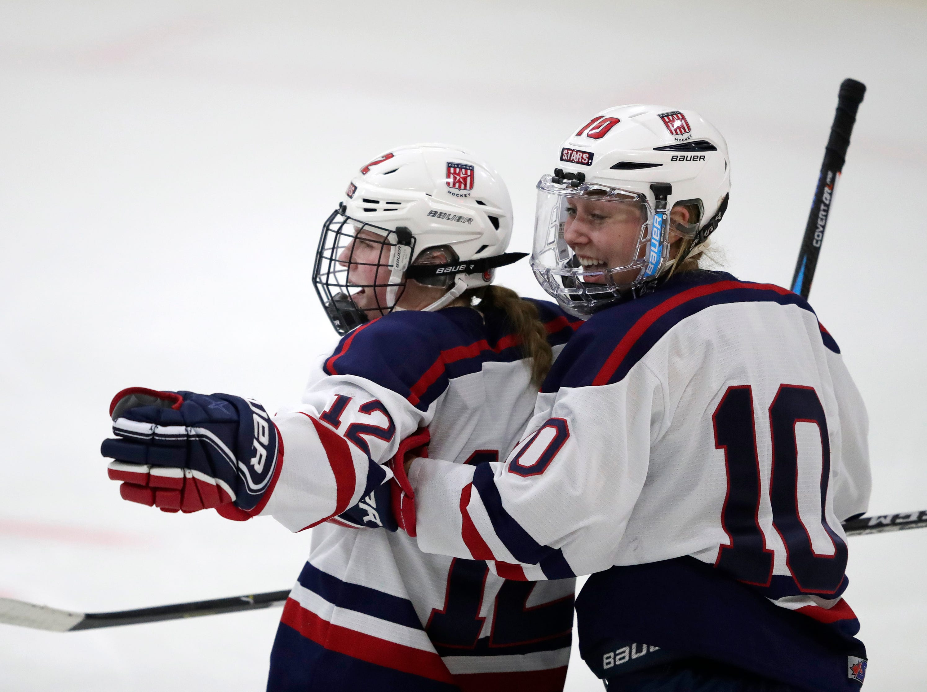 Fox Cities Stars' Annika Horman (12) celebrates scoring a goal with teammate Madelynn Jablonski (10) against the Warbirds during their girls hockey game Thursday, January 10, 2019, at Tri-County Ice Arena in Fox Crossing, Wis. 