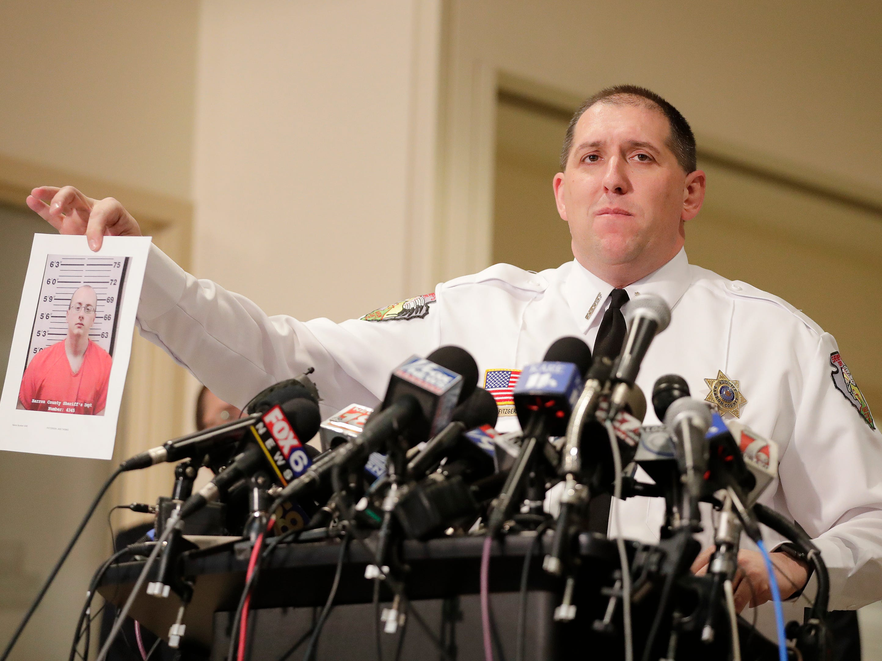 Barron County Sheriff Chris Fitzgerald holds up a photo of the suspect in custody for allegedly kidnapping Jayme Closs during a press conference at the Barron County Sheriff's Department on Friday, January 11, 2019 in Barron, Wis. Douglas County officials found 13-year-old Jayme Closs on Thursday near the northern Wisconsin town of Gordon. Jayme had been missing since Oct. 15, the same day her parents, James, 56, and Denise, 46, were found shot to death in their home outside Barron.