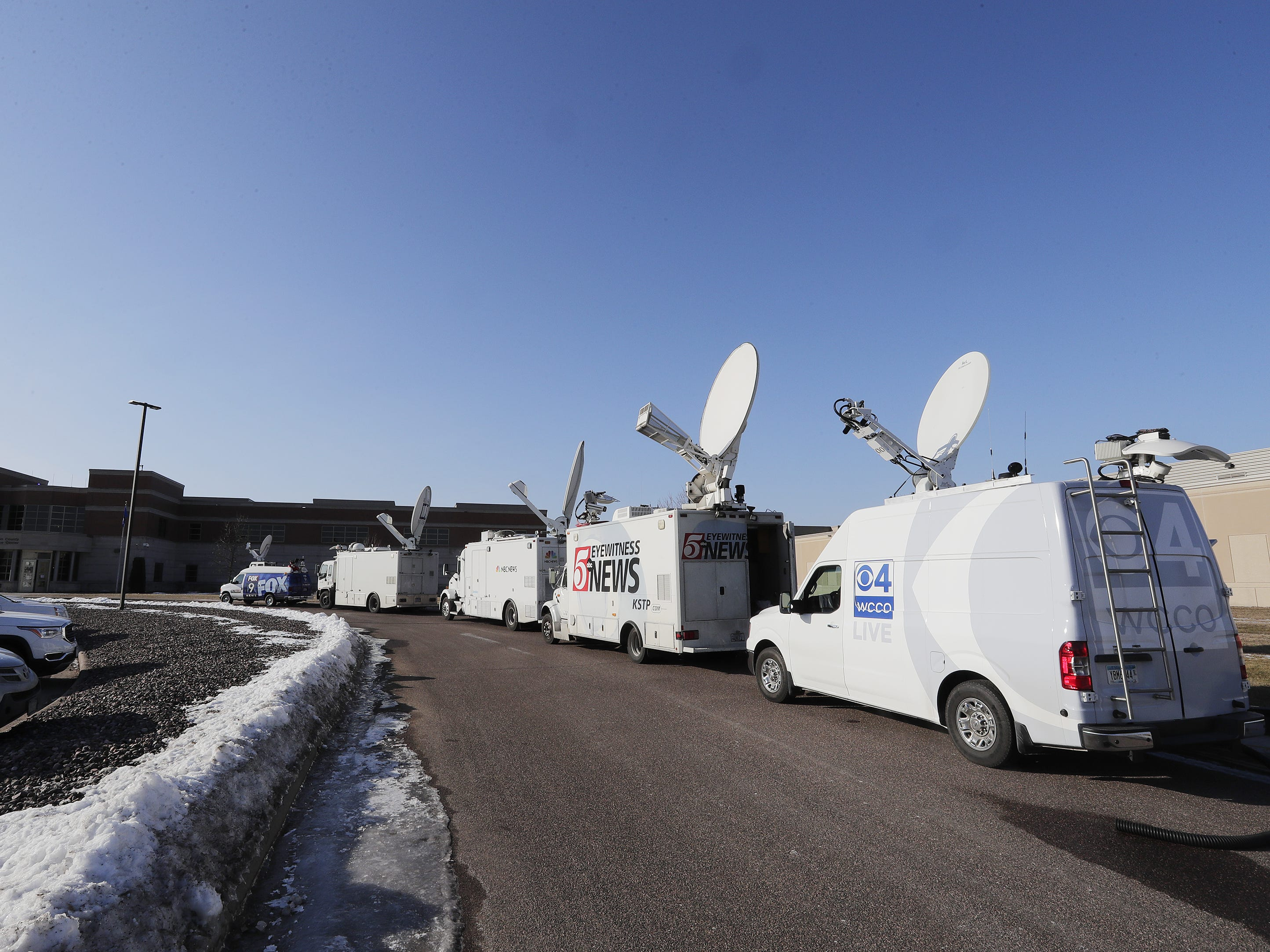 News television trucks are parked outside the Barron County Sheriff's Department on Friday, January 11, 2019 in Barron, Wis.