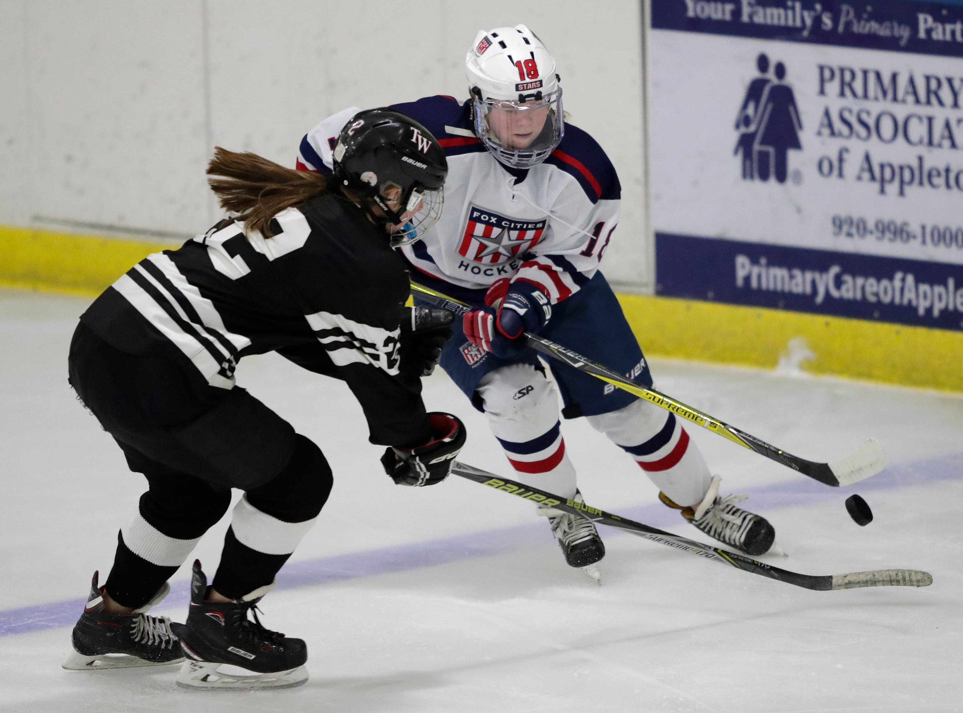 Fox Cities Stars' Madelynn Jablonski (10) tries to get past the Warbirds' Drew Deanovich (22) during their girls hockey game Thursday, January 10, 2019, at Tri-County Ice Arena in Fox Crossing, Wis. 