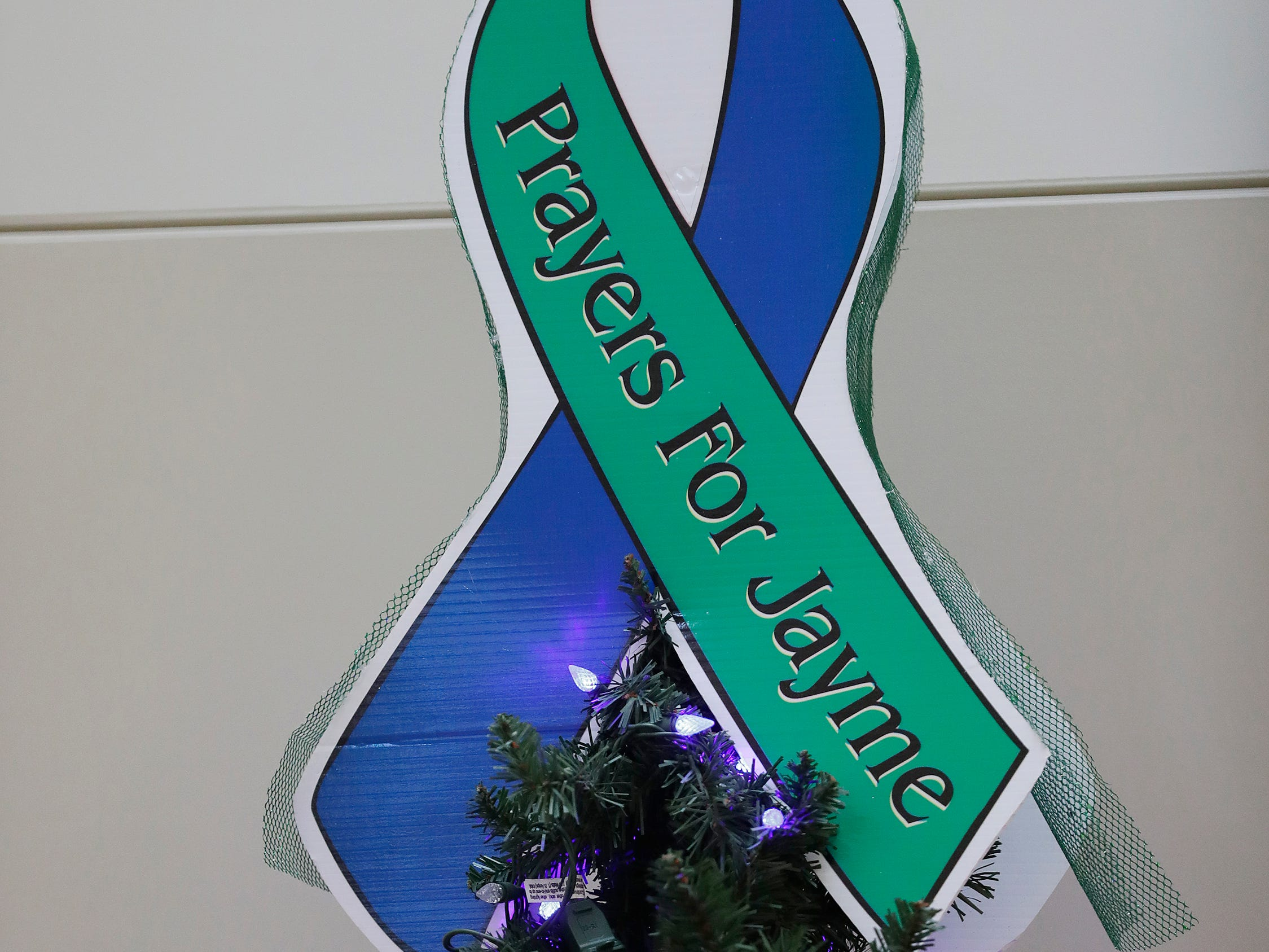 "A ""prayers for Jayme"" ribbon is displayed at the Barron County Sheriff's Department on Friday, January 11, 2019 in Barron, Wis. Douglas County officials found 13-year-old Jayme Closs on Thursday near the northern Wisconsin town of Gordon. Jayme had been missing since Oct. 15, the same day her parents, James, 56, and Denise, 46, were found shot to death in their home outside Barron."