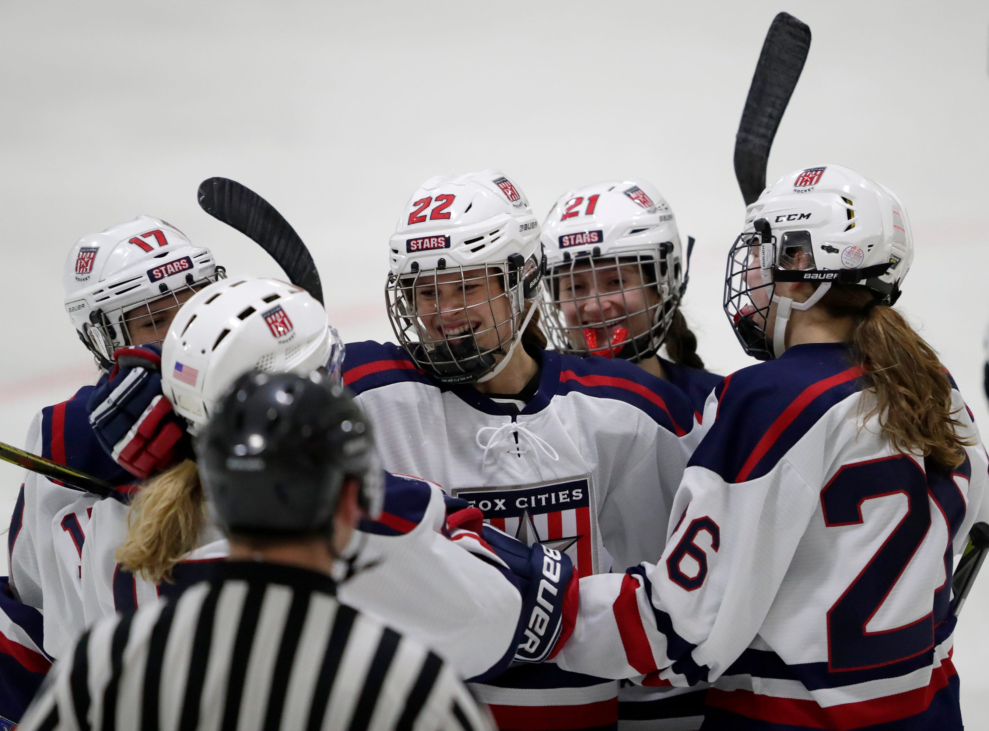 Fox Cities Stars' Riley Maulick (22) celebrates scoring a goal with teammates against the Warbirds during their girls hockey game Thursday, January 10, 2019, at Tri-County Ice Arena in Fox Crossing, Wis. 