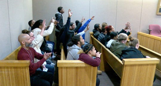 Karon Council's family and friends wave to him as he left the courtroom after his sentencing for the shooting death 10-year-old Yovanni Banos-Merino in Asbury Park.  He was sentenced before Judge Richard W. English in State Superior Court in Freehold Friday, January 11, 2019.