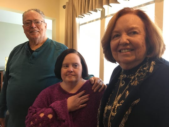 Left to right: David Murphy, Michelle Murphy and Leone Murphy in their Farmingdale home.