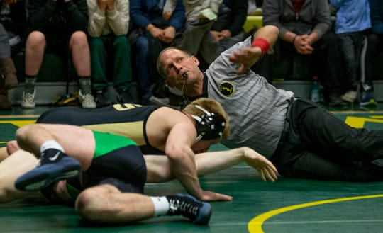 Referee Ed Tonnesson calls the pin in the 170-pound bout as Southern's Haven Tatarek pinned Brick Memorial's Ean Mueller.