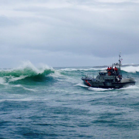 The U.S. Coast Guard search Yaquina Bay for crew members of the capsized fishing vessel Mary B II.