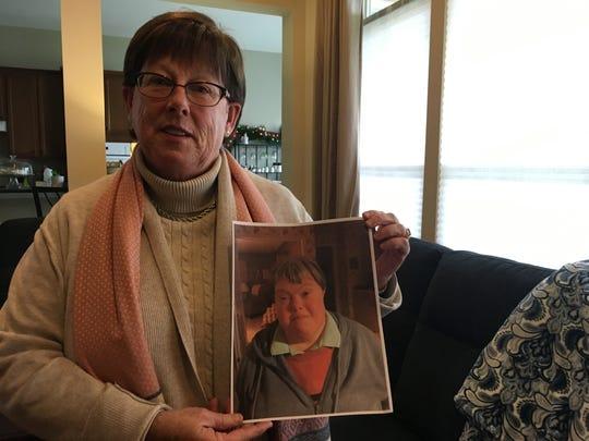 Jane Boyle holds a photo of her sister Ellen Boyle.