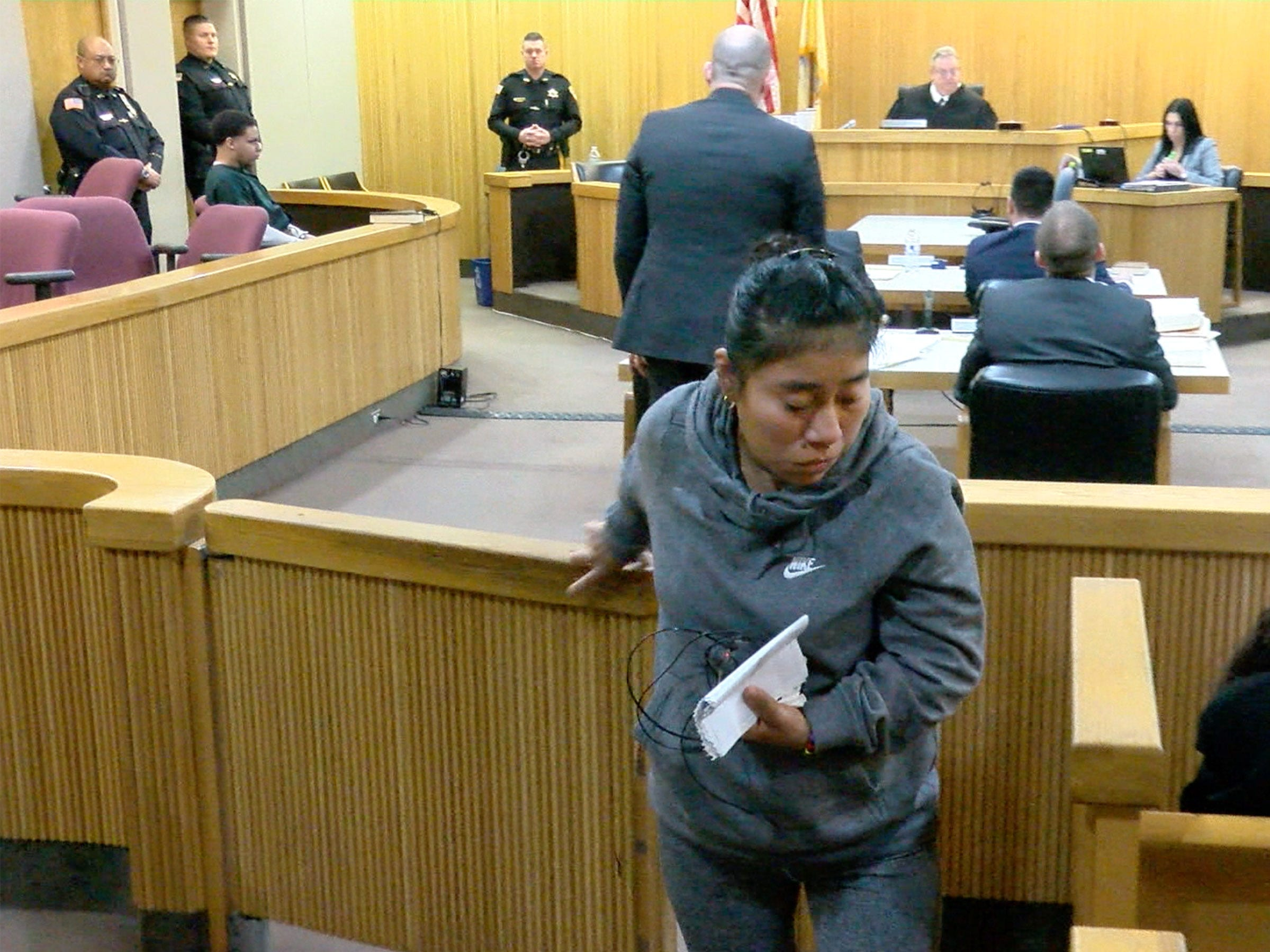 Yovanni Banos-Merino's mother Lilia Merino returns to her seat after she read letters to the court during the sentencing of Karon Council for the shooting death of her son in Asbury Park.  Council was sentenced before Judge Richard W. English in State Superior Court in Freehold Friday, January 11, 2019.