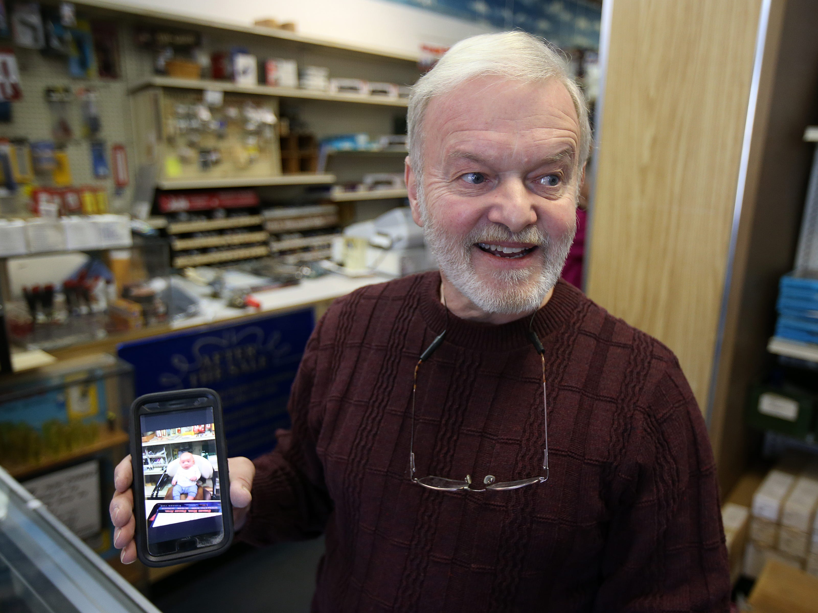 Frank Gustafson, owner of Jackson Hobby Shop, talks about retiring and closing after 50 years at Jackson Hobby Shop in Jackson, NJ Friday January 11, 2019.  He plans to stay in Jackson so he can be close to his 5-month-old grandson, Grayson, who is pictured on his phone.
