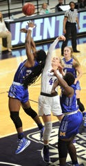 ACU's Lexie Ducat (44) battles a McNeese player for a rebound. The Wildcats won the Southland Conference game 109-52 on Wednesday, Jan. 9, 2019, at Moody Coliseum.