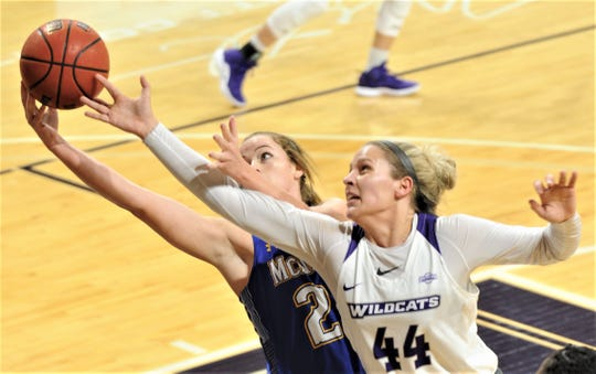 ACU's Lexie Ducat (44) battles McNeese's Maddisen Martin for a rebound. The Wildcats won the Southland Conference game 109-52 on Wednesday, Jan. 9, 2019, at Moody Coliseum.