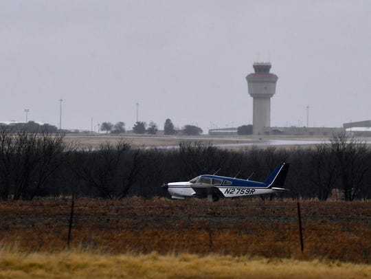 An airplane rests in a field southeast of Abilene Regional Airport on Friday. The pilot was not able to make it to the runway and had to land here, which is just north of Elmdale Road South.