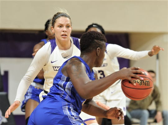 ACU's Lexie Ducat defends against a McNeese player during a Southland Conference game Wednesday, Jan. 9, 2019, at Moody Coliseum. ACU won 109-52.