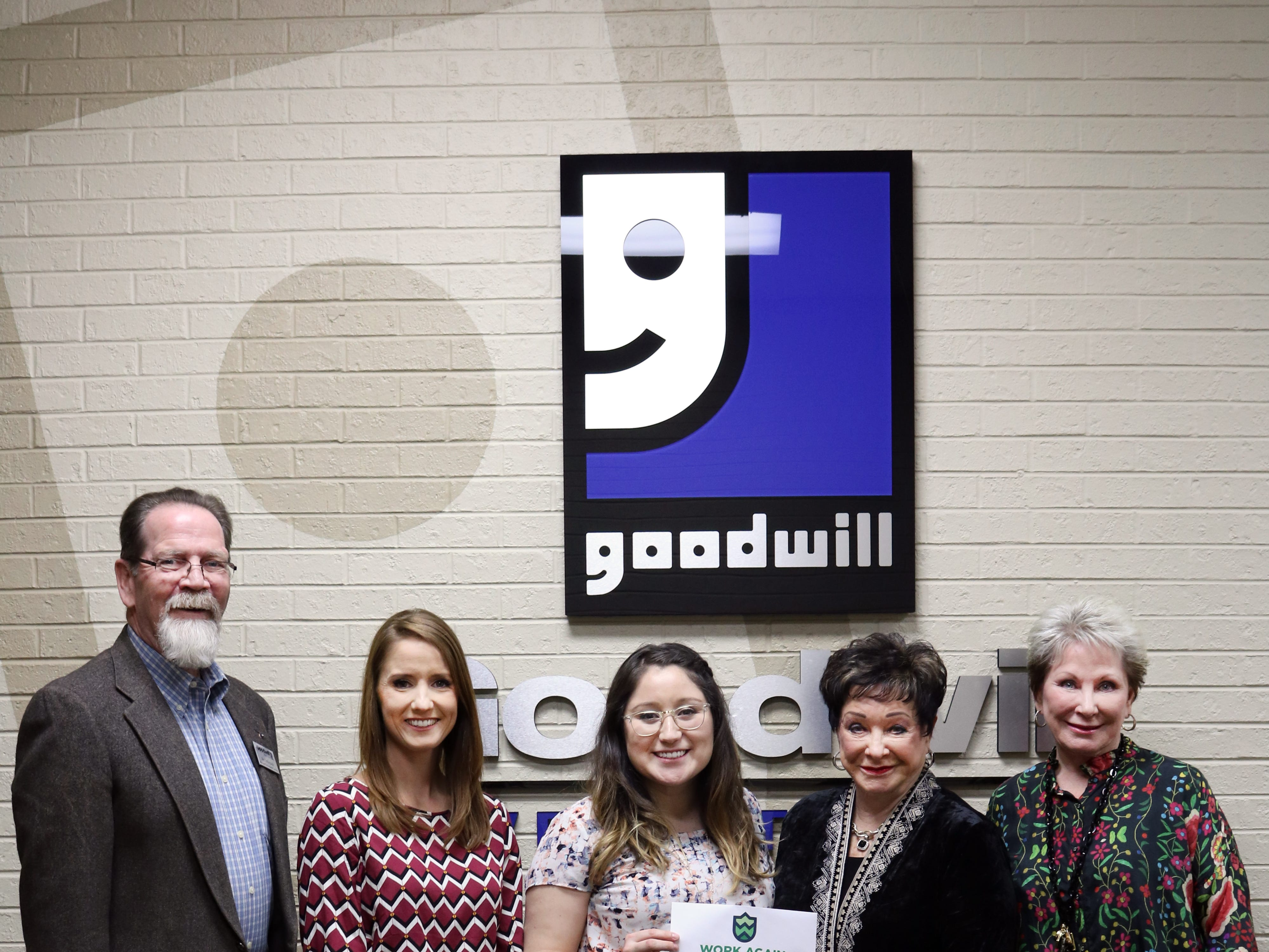 Billye Proctor Shaw and Yanell Rieder present $20,000 raised at the inaugural Women, Bags & Bingo event to Work Again West Texas. The program, run by Goodwill-West Texas, will launch in 2019 to help to provide jobs for people experiencing homelessness.