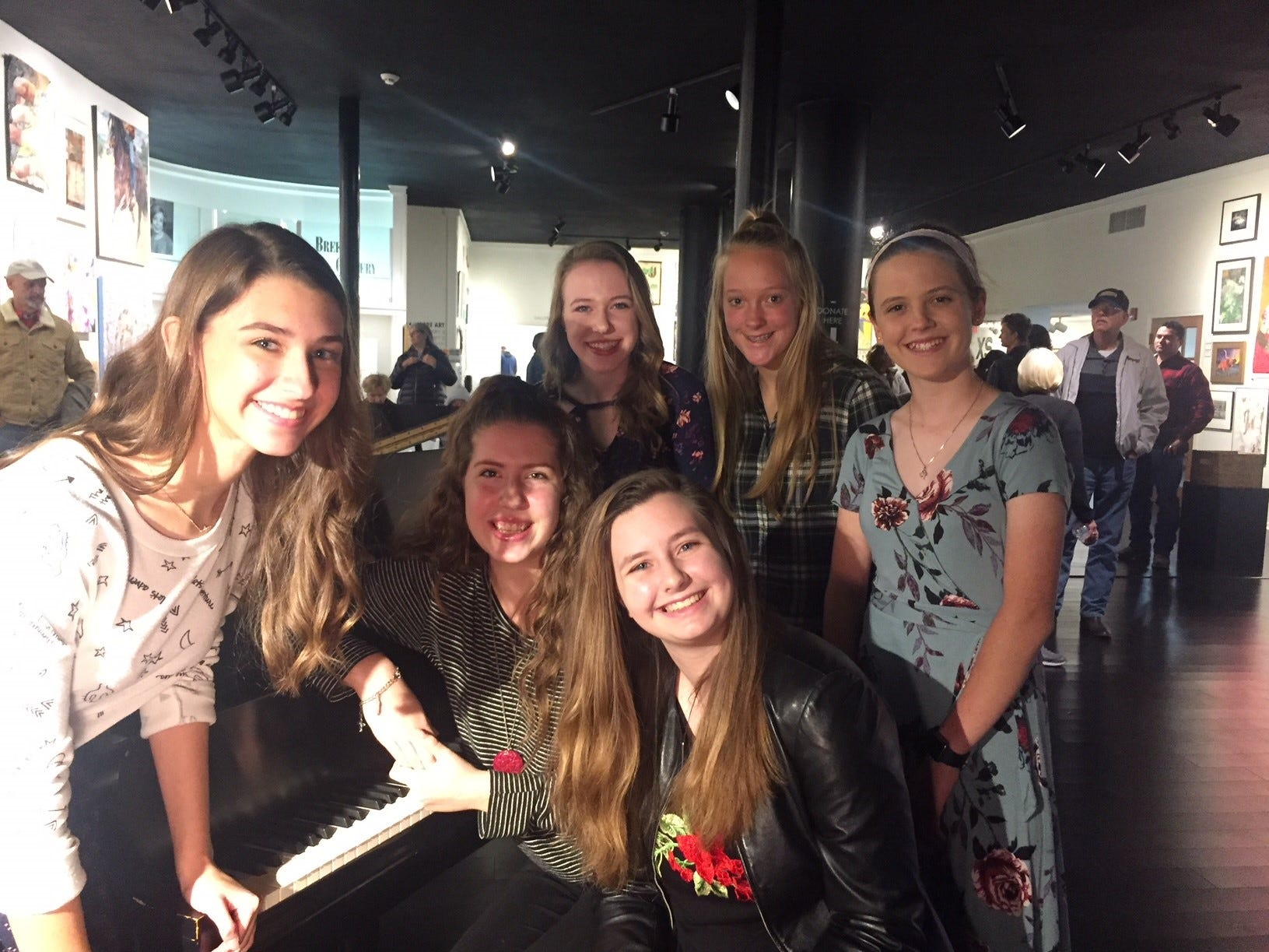 Katie Moore, Isabelle Patterson, Rachel Flatt, Ashton Martin, Ali McElhaney and Amy Bond play the piano at the Center for Contemporary Arts during ArtWalk. All are students of Kathie Goodrich.