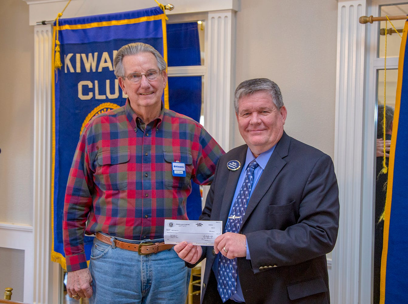 Don Paige, community service chair of the Kiwanis Club of Abilene, presents a $500 donation to Dan Cox, executive director of the Noah Project, at the club's Jan. 9 meeting.