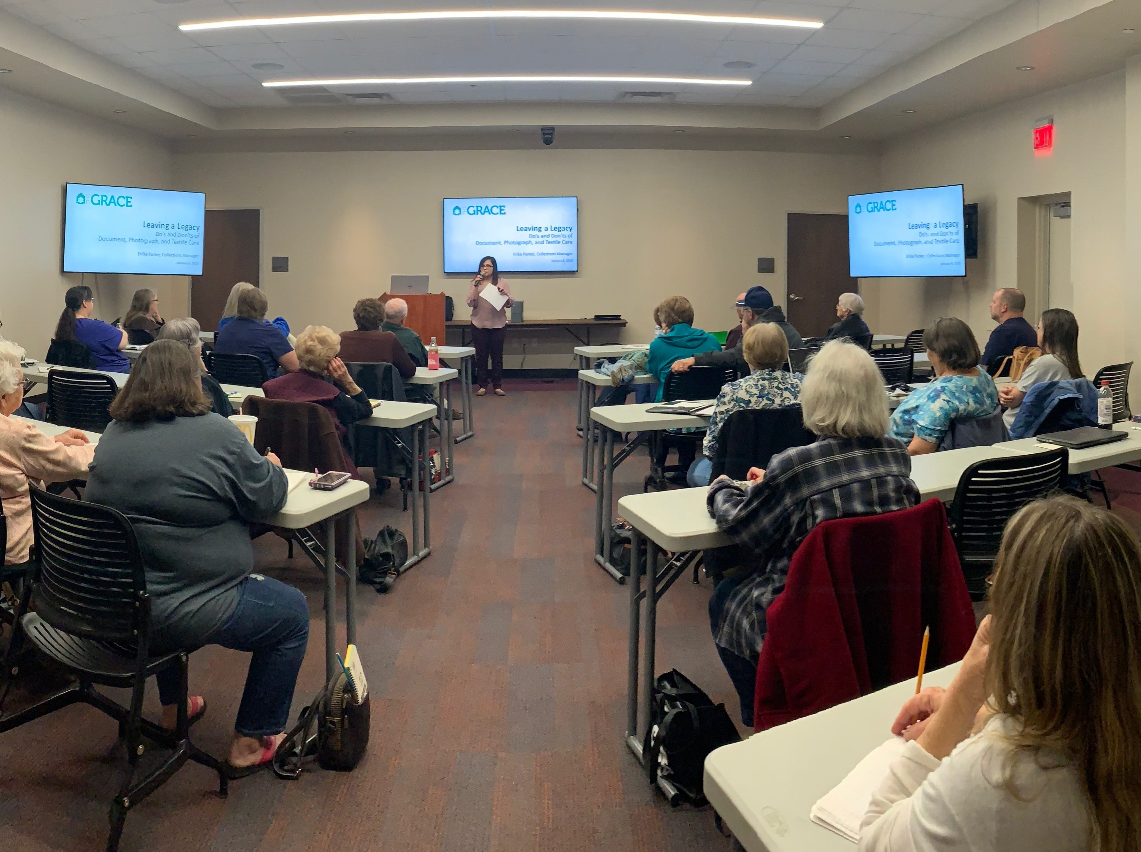 Erika Aragon Parker, collections manager at The Grace Museum, gives a presentation to the West Texas Genealogical Society about preserving family heirlooms, photographs and documents.