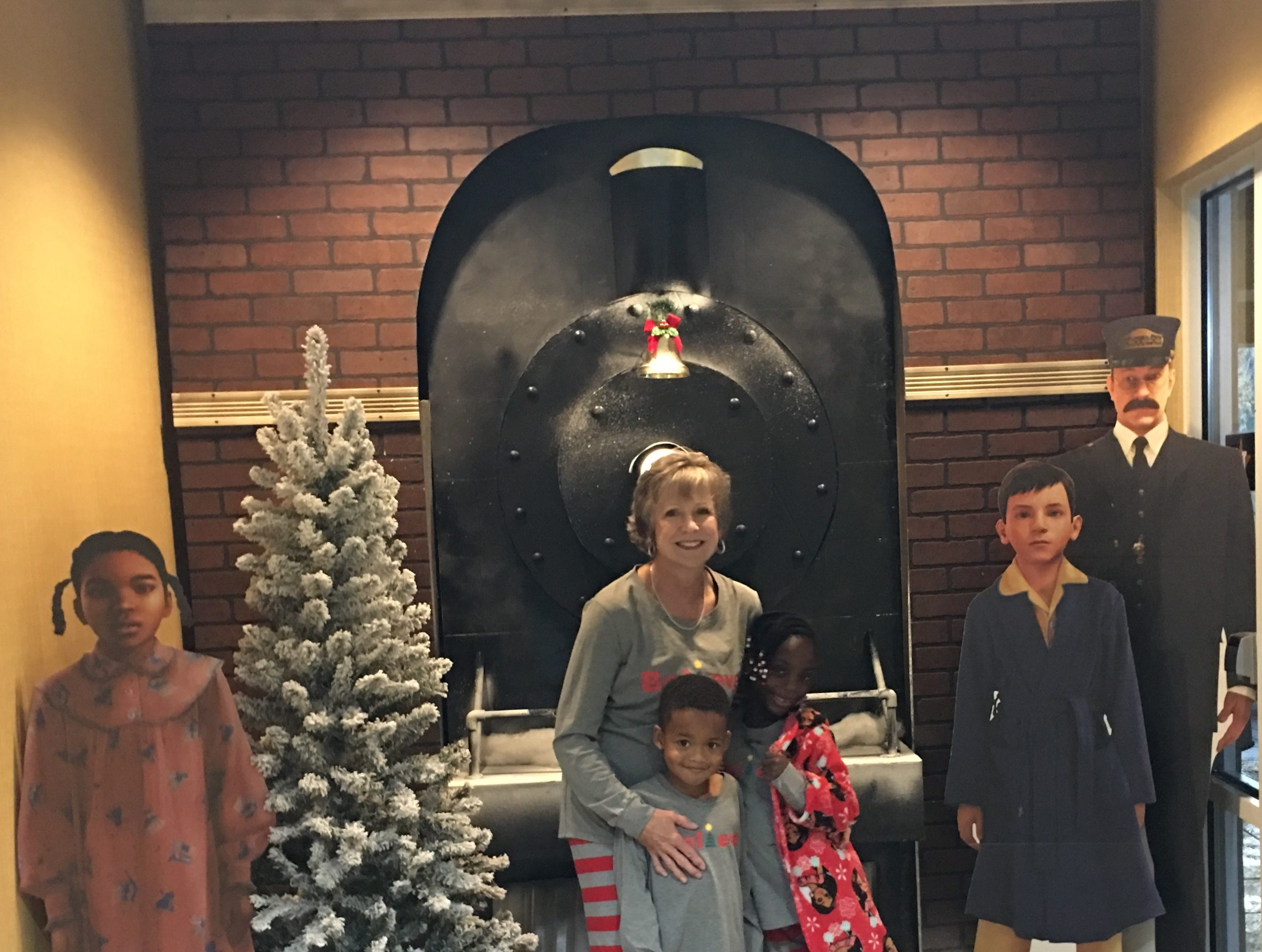 """Kim McLaughlin and her children Zack and Keshia visit the """"Polar Express"""" train ride in Palestine for Christmas."""
