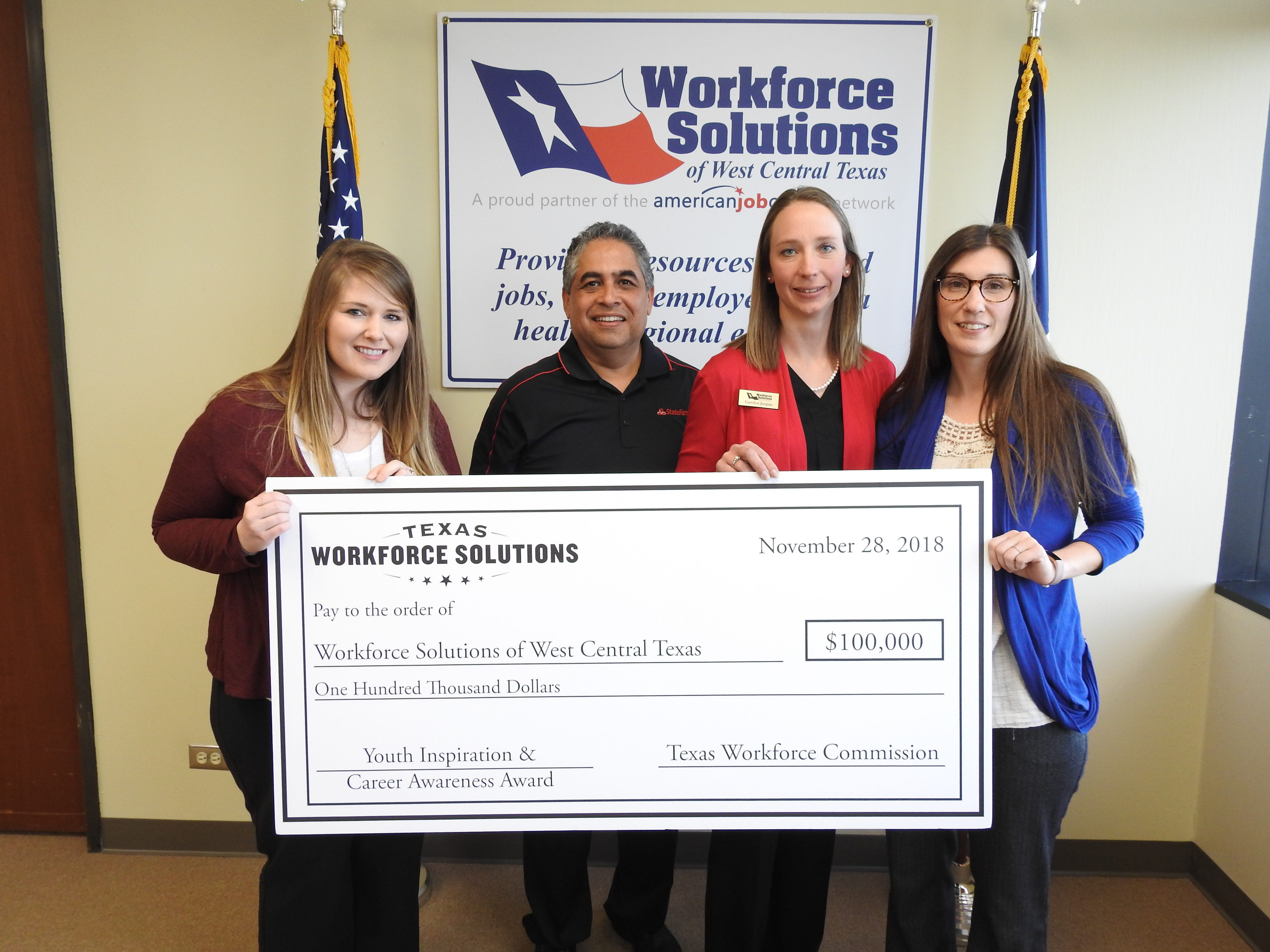 """As part of the """"Red Carpet Premiere Careers in Action"""" Youth Inspiration & Career Awareness Initiative, Workforce Solutions of West Central Texas was presented a $100,000 award on Nov. 27. From left: Lindsey Phillips, board chairman Samuel Garcia, Garolyn Jergins and Alyssa Goodgame."""