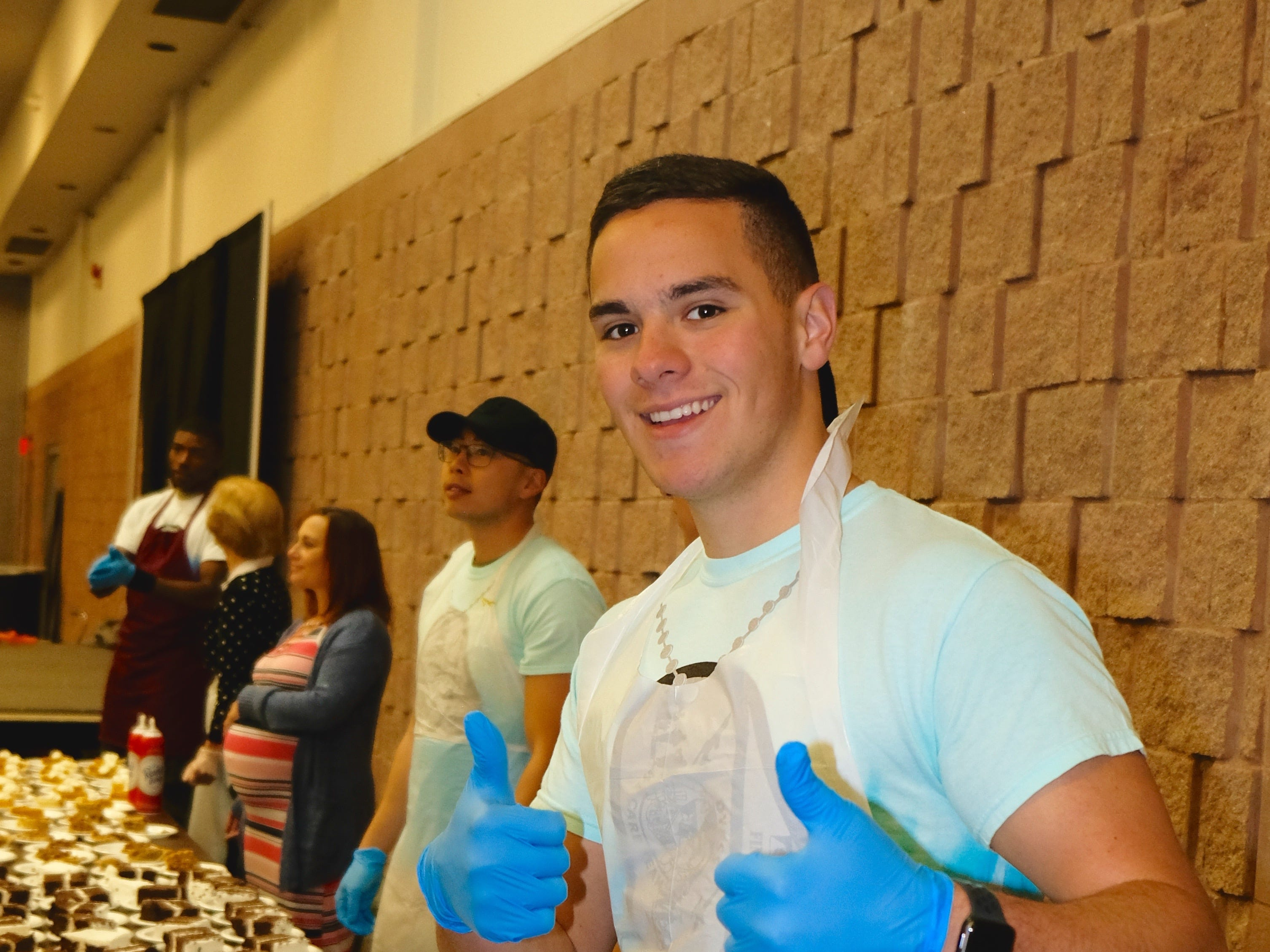 Airman 1st Class Kevin Archbold, of the 7th Component Maintenance Squadron, organizes desserts at the Veterans Thanksgiving Dinner.