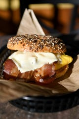 A sandwich with bacon, egg and cheese is created with a house-made bagel at Ziggy's Bakery & Deli.