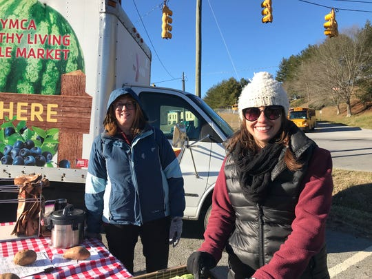 Nutrition Director of Operations and Clinical Integration Lauren Furgiule (right) with a volunteer from Buncombe County distributing hot cabbage soup.