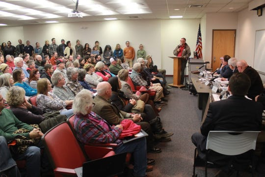 Keith Green, one of 10 residents to speak against a proposed asphalt plant in Madison County, addresses a packed session of the Madison County Board of Commissioners Jan. 8.