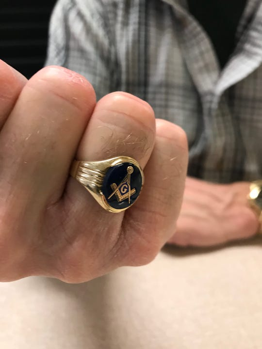 A Masonic ring, worn by Mark Waterman.