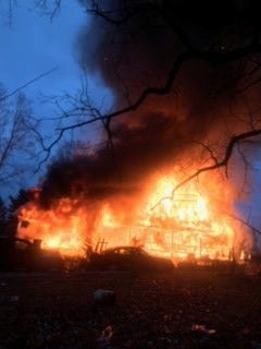 Bellevue firefighters said a home on Huff Road in Barry County's Assyria Township was engulfed in flames when they arrived Thursday evening.