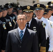 Scranton Mayor Bill Courtright joins police officers at services July 16, 2015, for a patrolman fatally injured while pursuing three 17-year-old  suspects.