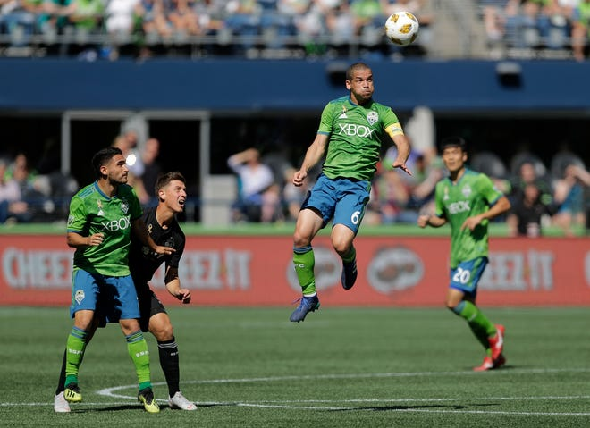 Seattle Sounders midfielder Osvaldo Alonso heads the ball during an MLS match in September. Alonso, the last member of the Sounders' first MLS roster, signed with Minnesota United on Thursday.