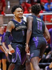 David Crisp (1) and Nahziah Carter (11) were Washington's top scorers during the Huskies' 69-53 win at Utah on Thursday.