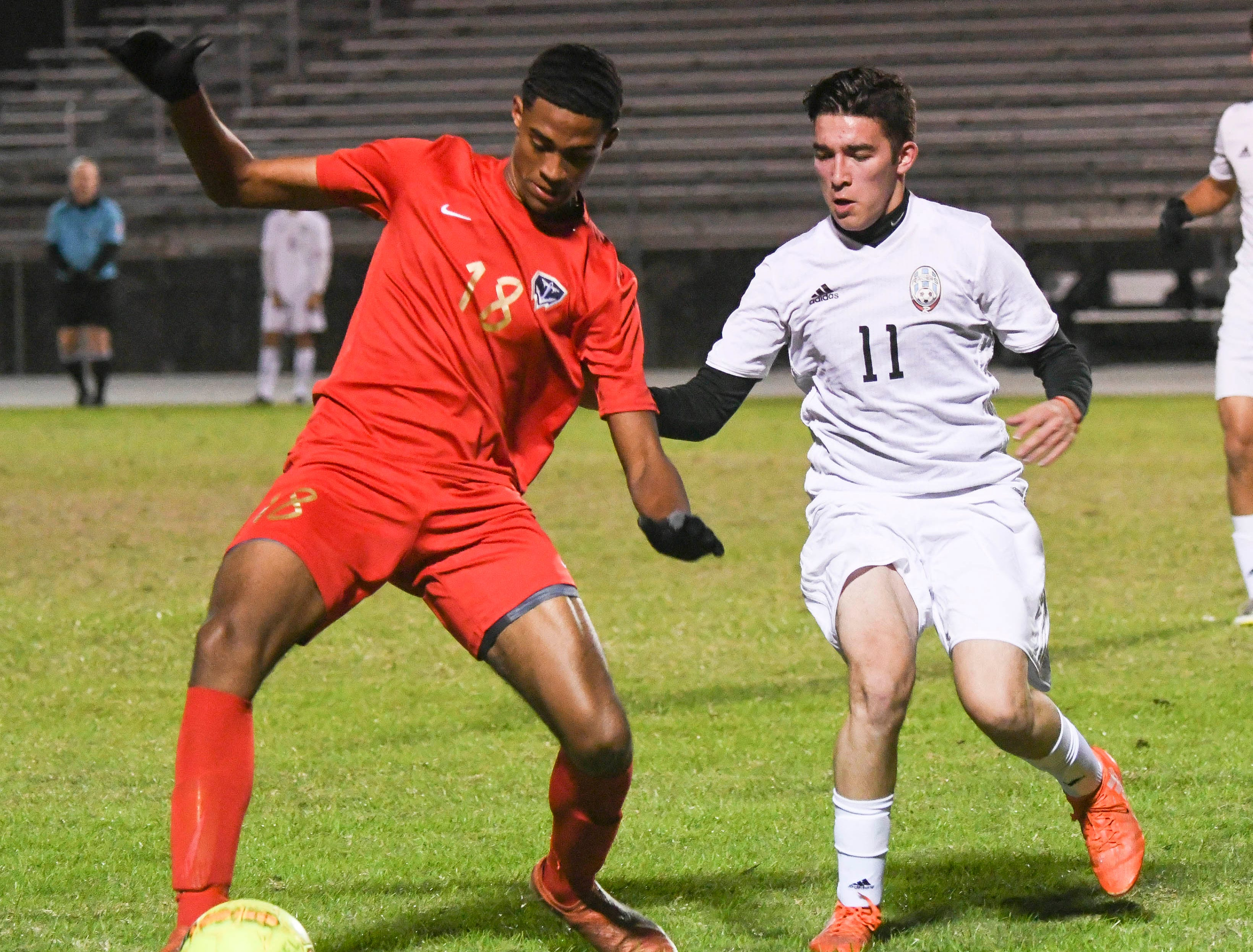 Eau Gallie's Bruce Smith tries to keep the ball away from Beto Garza of Rockledge during Thursday's game in Melbourne.