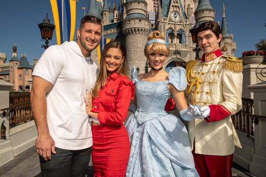 Football and baseball star Tim Tebow and his then-fiancee Demi-Leigh Nel-Peters celebrated at Disney World. Tebow has been to Brevard to speak about life's lessons.