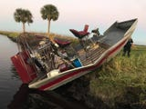 Three were injured, one seriously, in an airboat crash near Lone Cabbage Fish Camp Thursday.