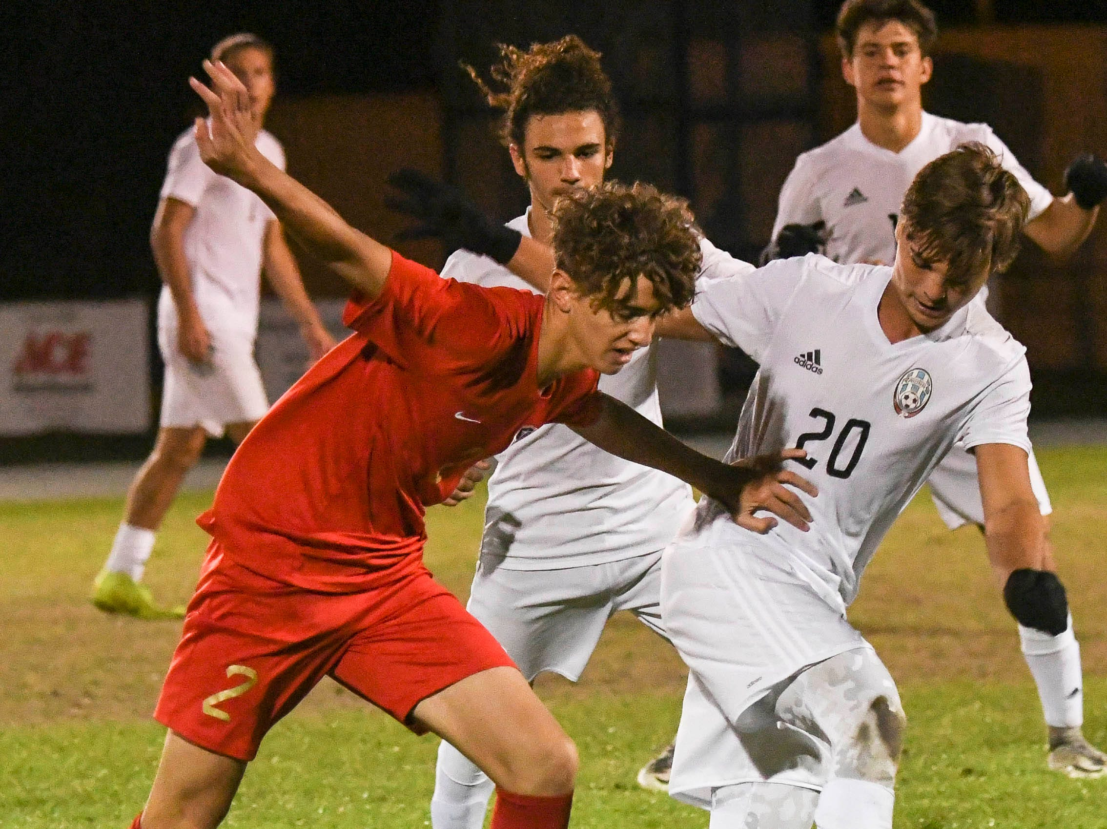 Alex Masedo of Eau Gallie and Taylor Williams of Rockledge fight for control of the ball during Thursday's game in Melbourne.