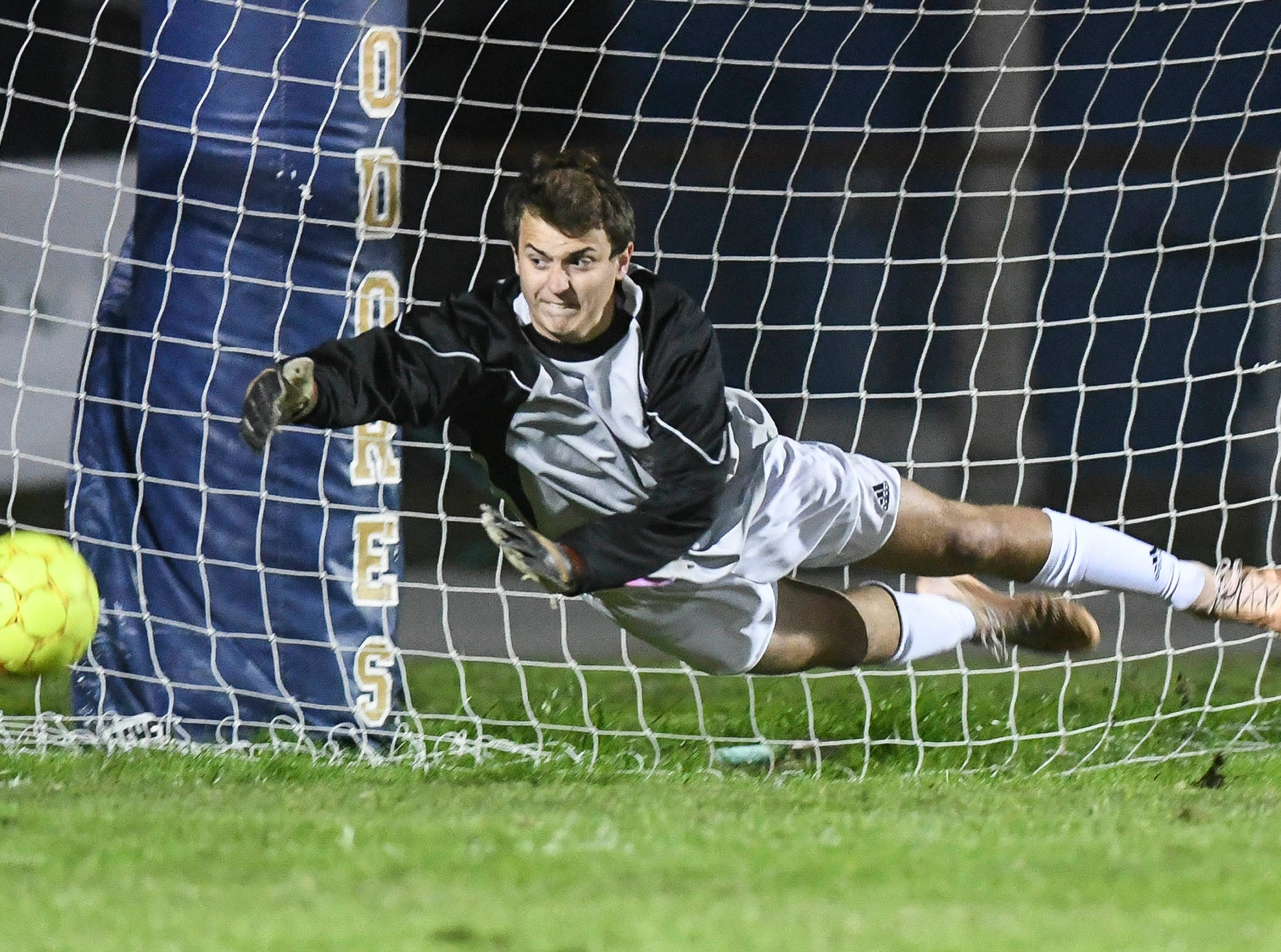 Rockledge goalkeeper Alex Rahal makes a diving save during Thursday's game in Melbourne.
