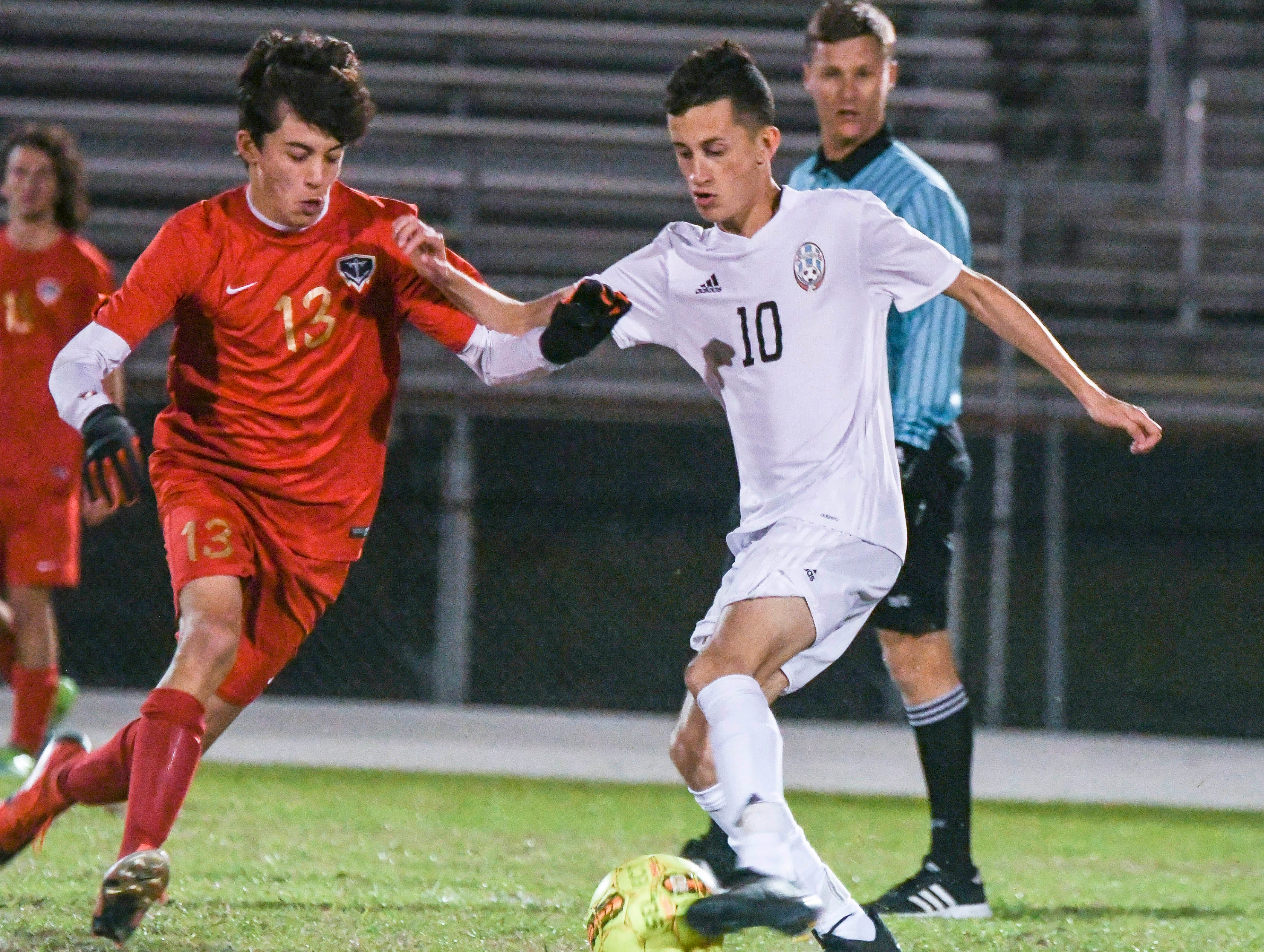 Jaxon Supernaw of Eau Gallie battles with Beto Garza of Rockledge during Thursday's game in Melbourne.