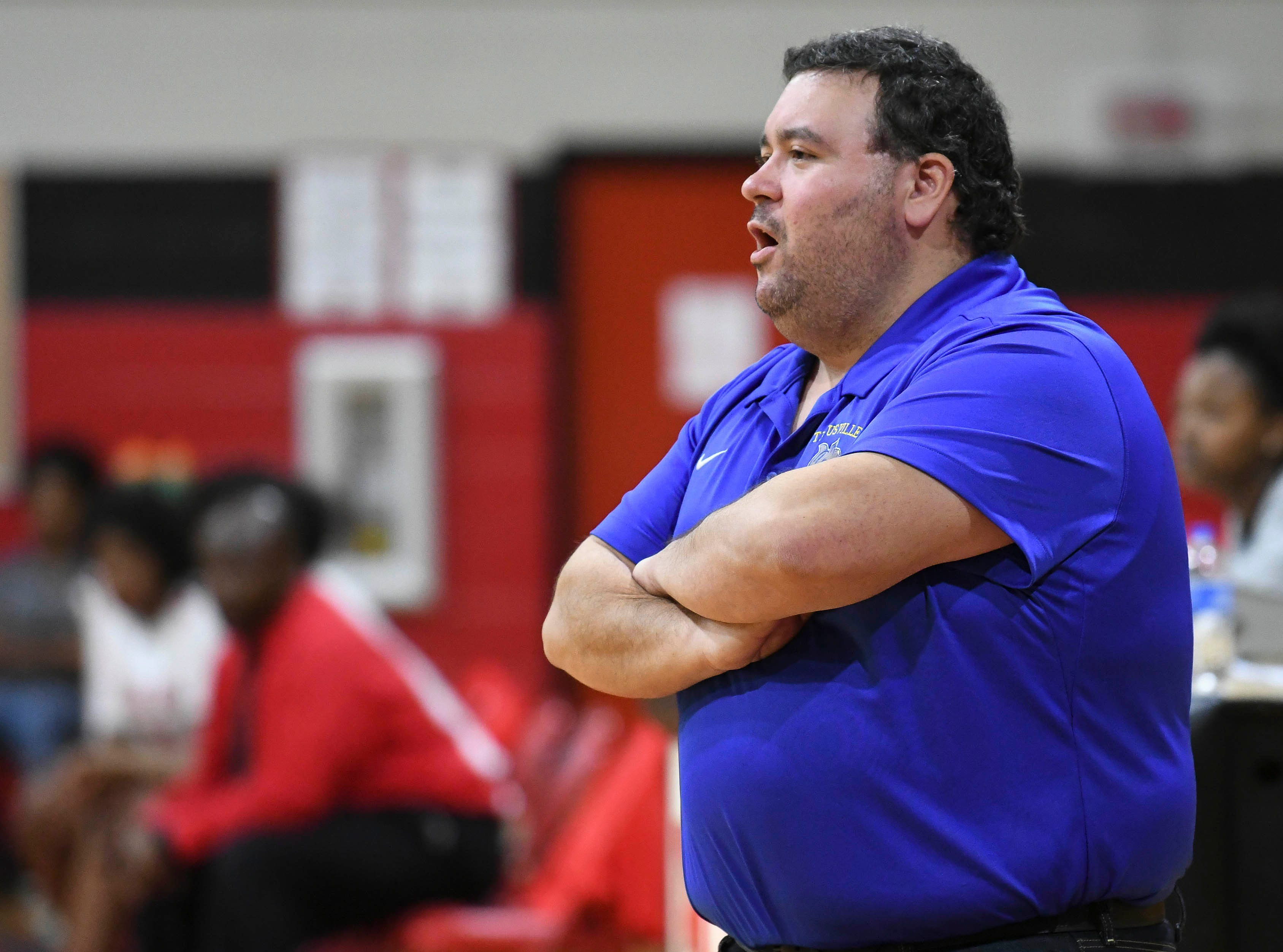 Titusville girls basketball head coach Rey Ortega prompts his players during Thursday's game against Palm Bay.