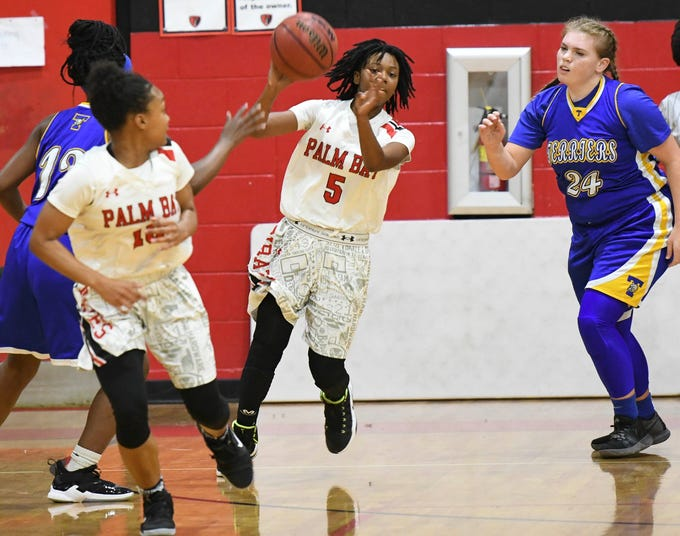 Palm Bay's Amaya Bozeman passes to teammate Gaby Alfonso on a fast break during Thursday's game.