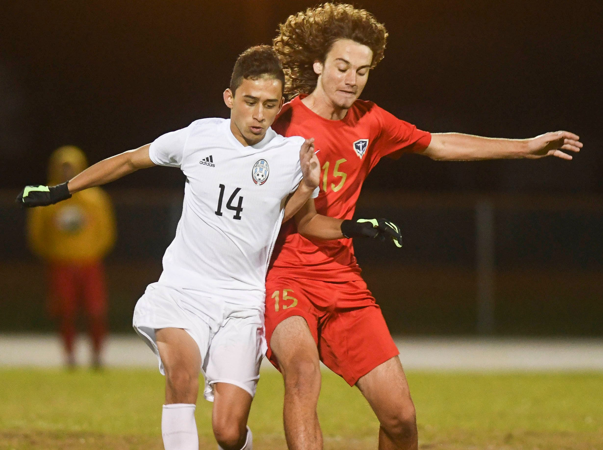 Luis Esteban Son of Rockledge fights for control of the ball with Caleb Webb of Eau Gallie during Thursday's game in Melbourne.