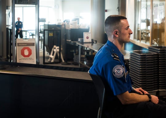 TSA agents at Burlington International Airport in South Burlington, VT, await passengers to screen at a security checkpoint on Friday, Jan. 11, 2019. Despite no paychecks going out, agents continued to report to work, according to airport Federal Security Director Bruce McDonald, but said that agents are working under mounting financial stress.