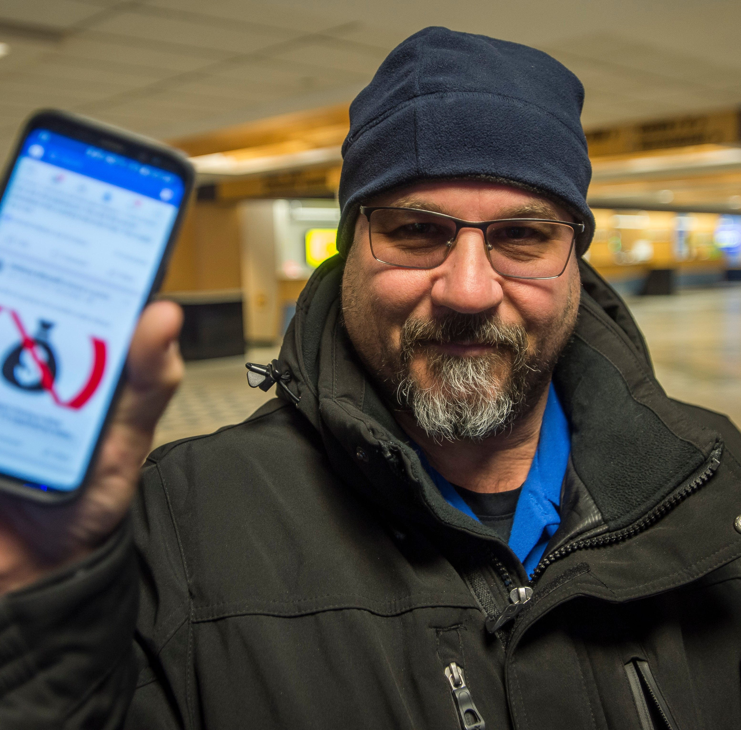 TSA agent Anthony Morselli of Georgia, VT, shows his GoFundMe post on Facebook before starting his shift at Burlington International Airport on Friday, Jan. 11, 2019. Morselli and his wife, both TSA agents, didn't get paid along with approximately 800,000 other federal workers and, to try to make ends meet, started the GoFundMe site to try to pay the bills as the government shutdown entered it's 21st day.
